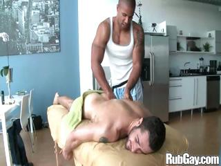 Tired unconcerned rugby player gets a nice complacent massage on his alongside plus exasperation from a masseur stud