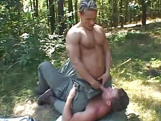 Two muscled gay studs having fun outdoor