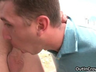 Blonde hunk gets penis sucked open-air
