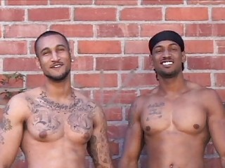 A handful of tattooed latin gays posing naked open-air