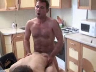 Dad fucks his boy in kitchen