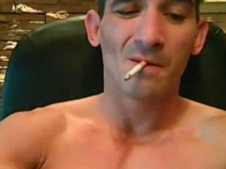 Tatooed tough impoverish smokes while strokes his cock